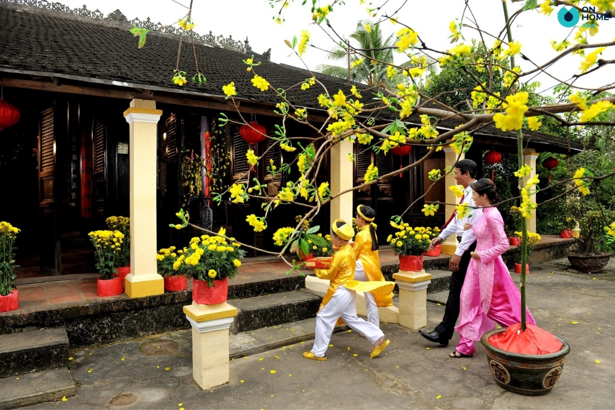 The act of being the first person to enter a house is called xông đất